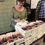 Signing lots of books!